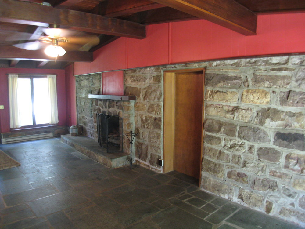 Rear Library/Study with Stone Fireplace