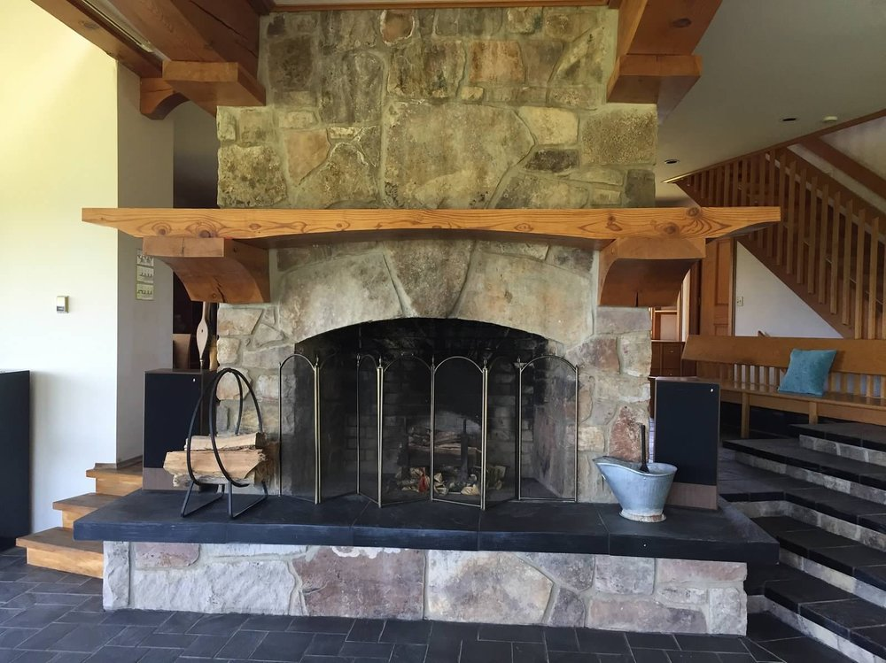 Main Floor Living Room Stone Fireplace