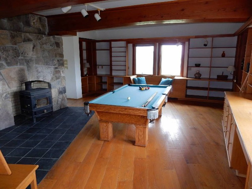 Main Floor Library/Pool Room with Wood Stove