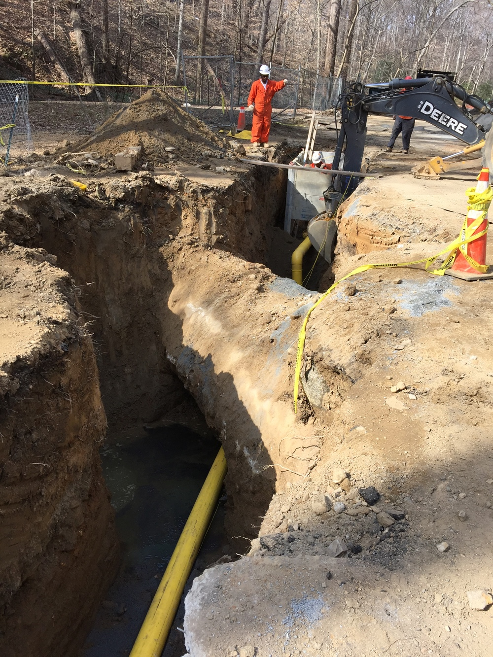 Threading a new gas line between existing storm water pipes
