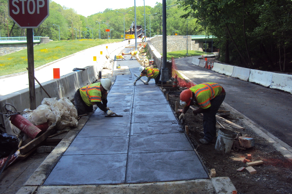 Concrete finishers cut the joint pattern into the fresh concrete. The joints reduce cracking by allowing the concrete to expand and contract in hot and cold weather.