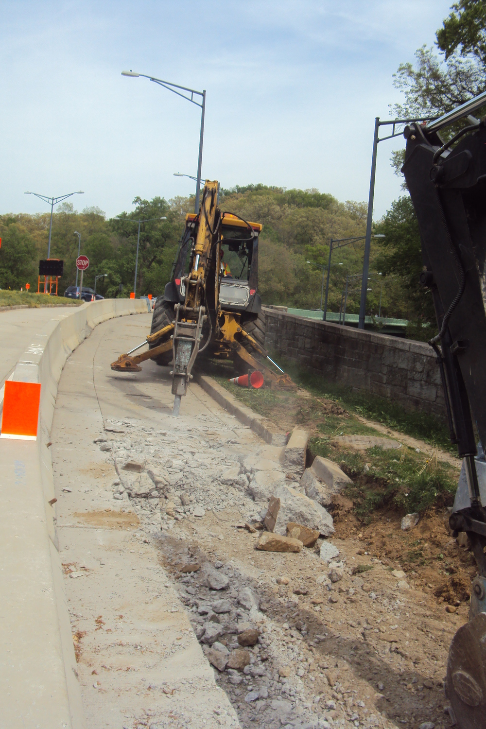Removing a section of the ramp to accommodate the new sidewalk