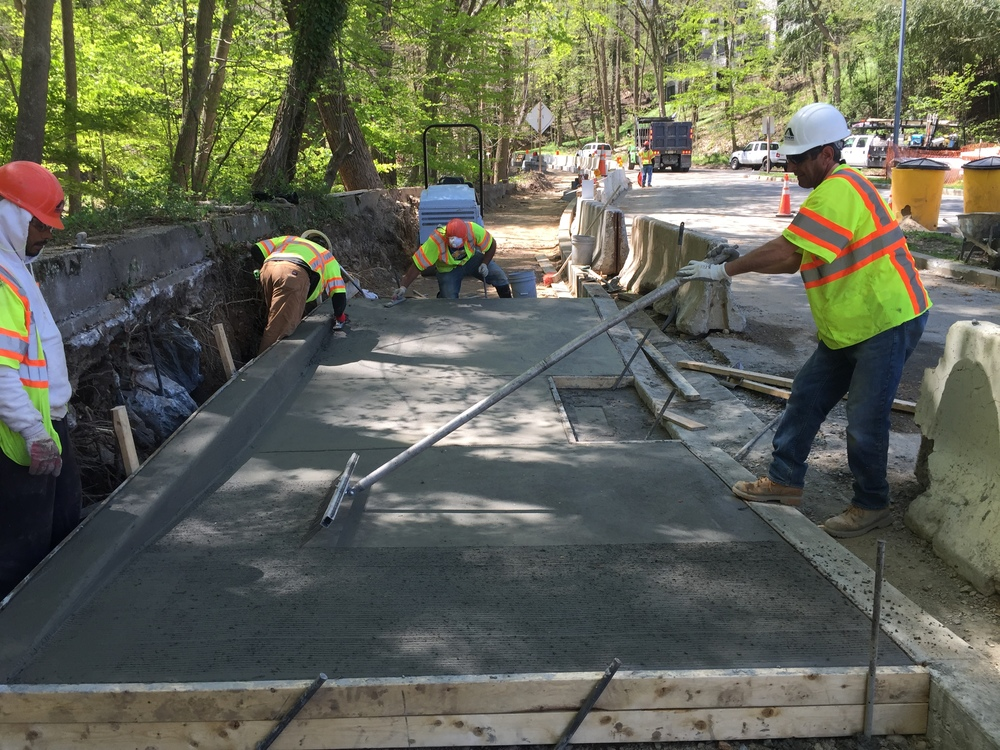 Concrete finishing for the ADA ramp at the Klingle Road Ramp to Beach Drive