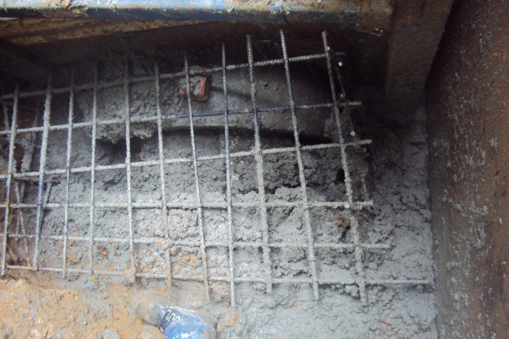 Reinforced concrete collars are installed at the ends of the newly installed pipe to ensure a watertight seal