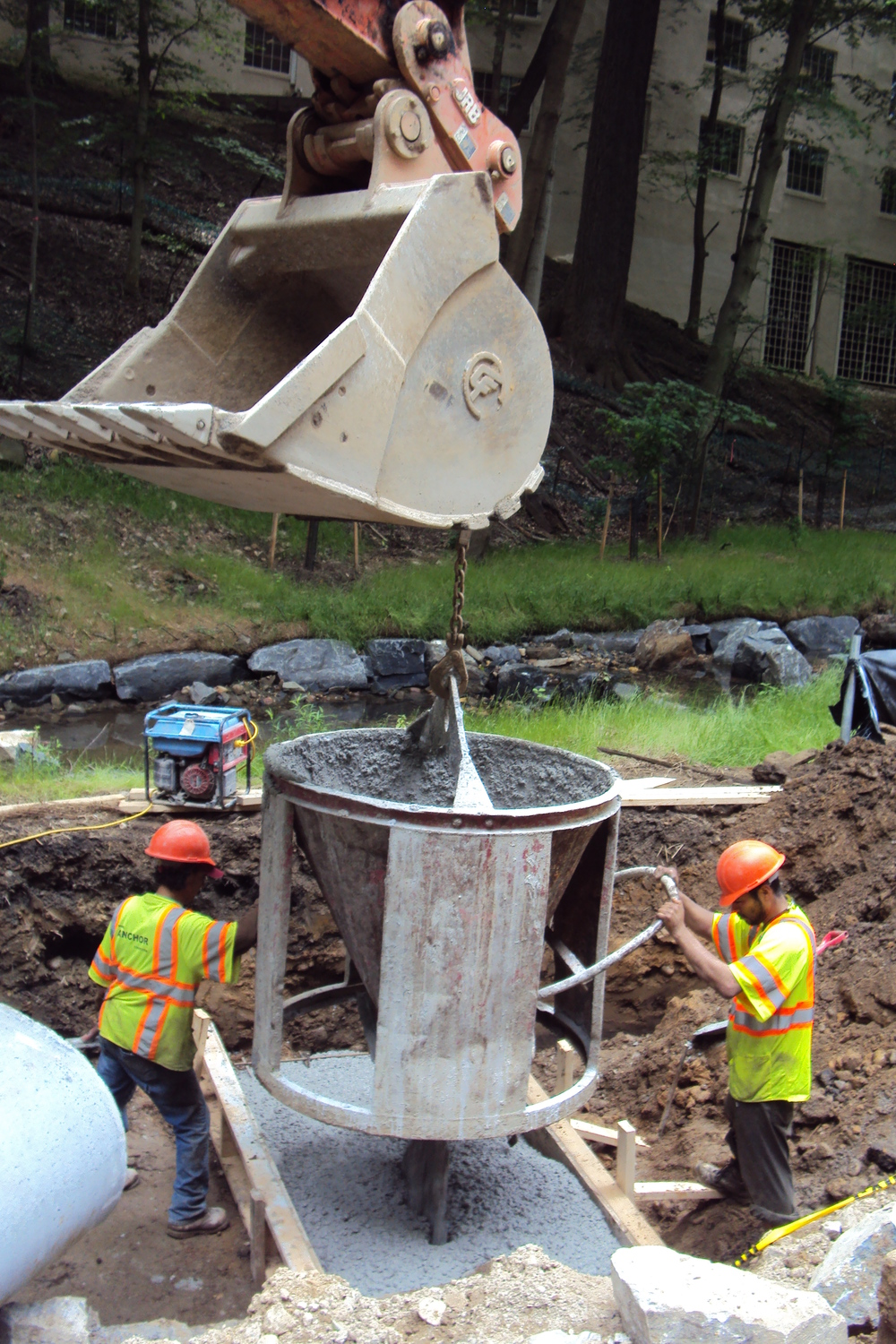 Placing concrete for the culvert control structure foundation