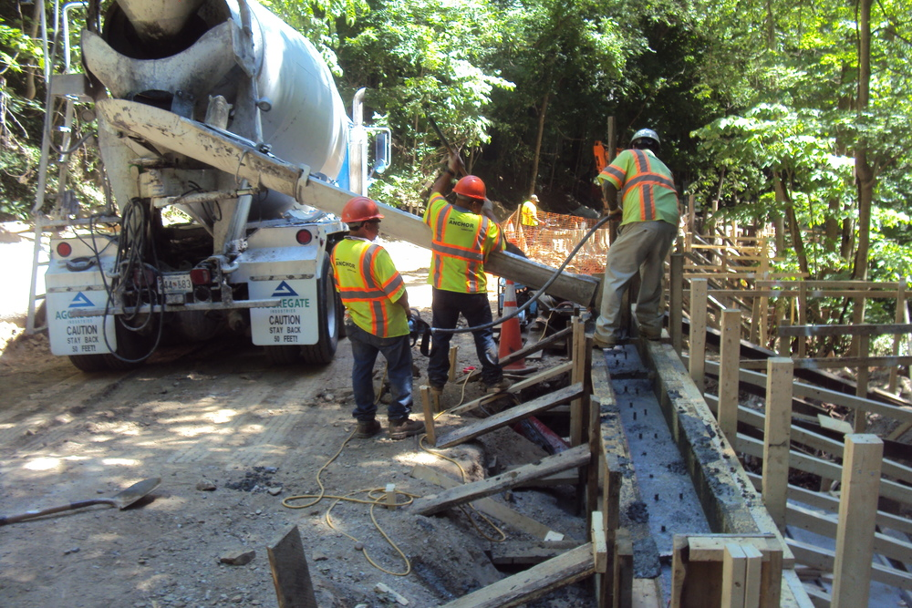 Pouring concrete for the shoring wall