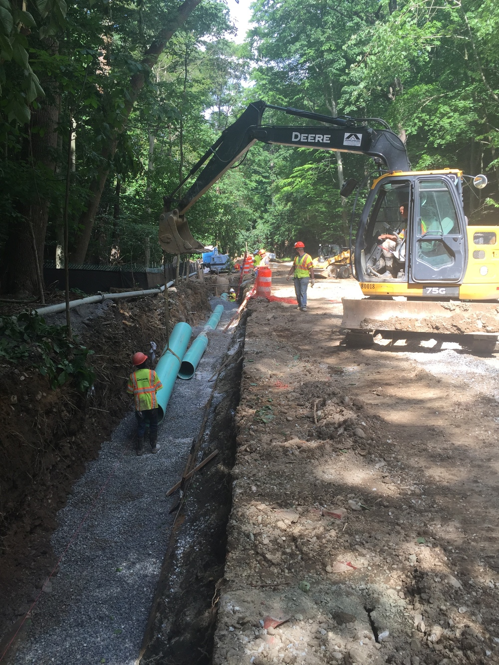 Following existing sewer removal, placing new PVC sewer pipe