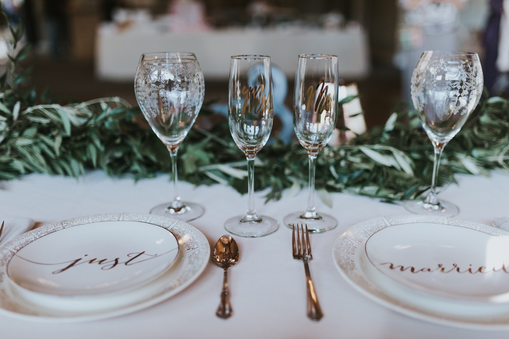 Champagne Flutes from Easy Tiger Co.; Other glassware, plates, and silverware from BHLDN