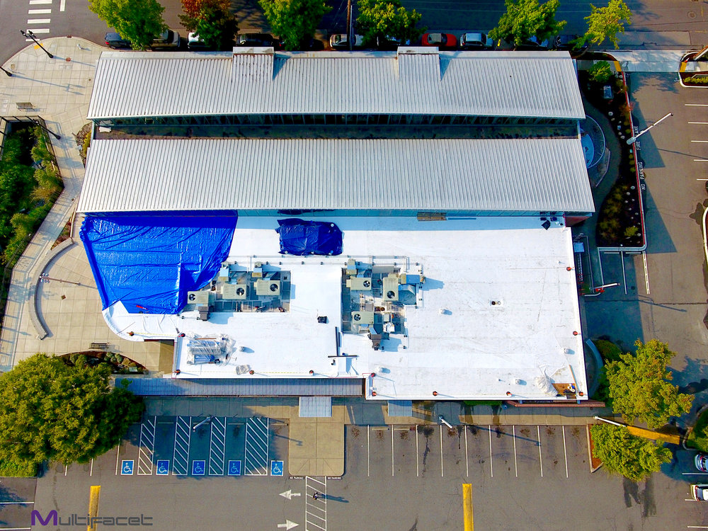 Aerial view of the new roofing system being installed on the Bothell Library