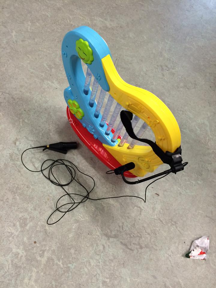 (This is how you prepare an $8 toy harp with a $500 contact microphone. Worth it? Yes.)