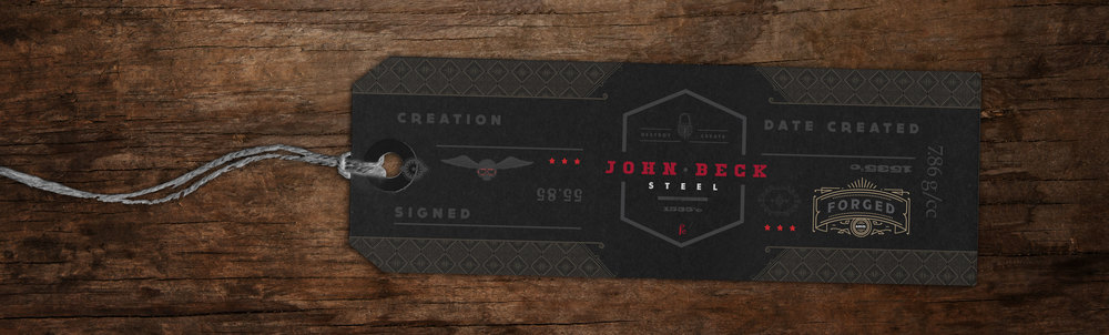 Black Tag with white, red and gold overprint.