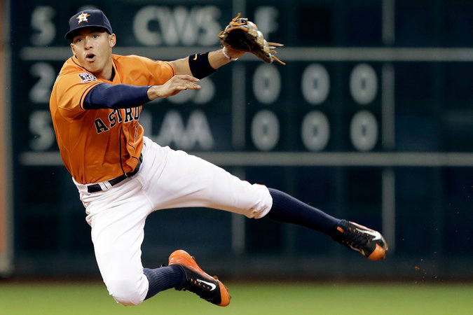 Carlos Correa, master of fielding, hitting, and proper hosiery styling.