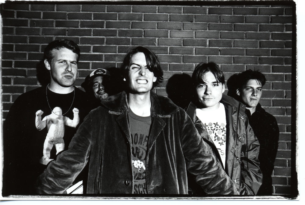 I couldn't find a photo of a band with a microwave. So here's a picture of Pavement, which seems like a band that knows its way around the electromagnetic spectrum.