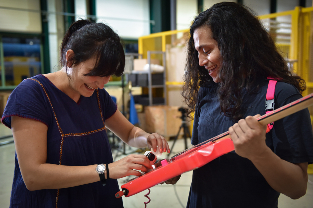 CERN's Noemi Caraban with Deerhoof guitarist Ed Rodriguez in SM-18 (Image: Marine Bass/CERN)