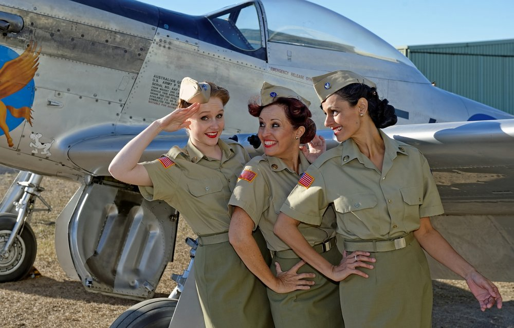 The Andrews Sisters brought laughter and happiness to many. They were very active in their patriotic duty — war time entertainment, volunteering their time— singing and dancing and signing autographs for the troops.  The Andrews Sisters Tribute Show consists of three sassy divas — Anita David, Kelsey Giarola and Cherryn Lomas. They are backed by the accomplished and lively Andrews Sisters Tribute Band.  Together the khaki-clad trio are bringing back the gorgeous 3-part harmony and toe-tapping tunes of the Andrews Sisters! Dance to Boogie-Woogie Bugle Boy, reminisce with Rum and Coca-Cola and Don't Sit Under The Apple Tree with anyone but the Andrews Sisters Tribute Show!