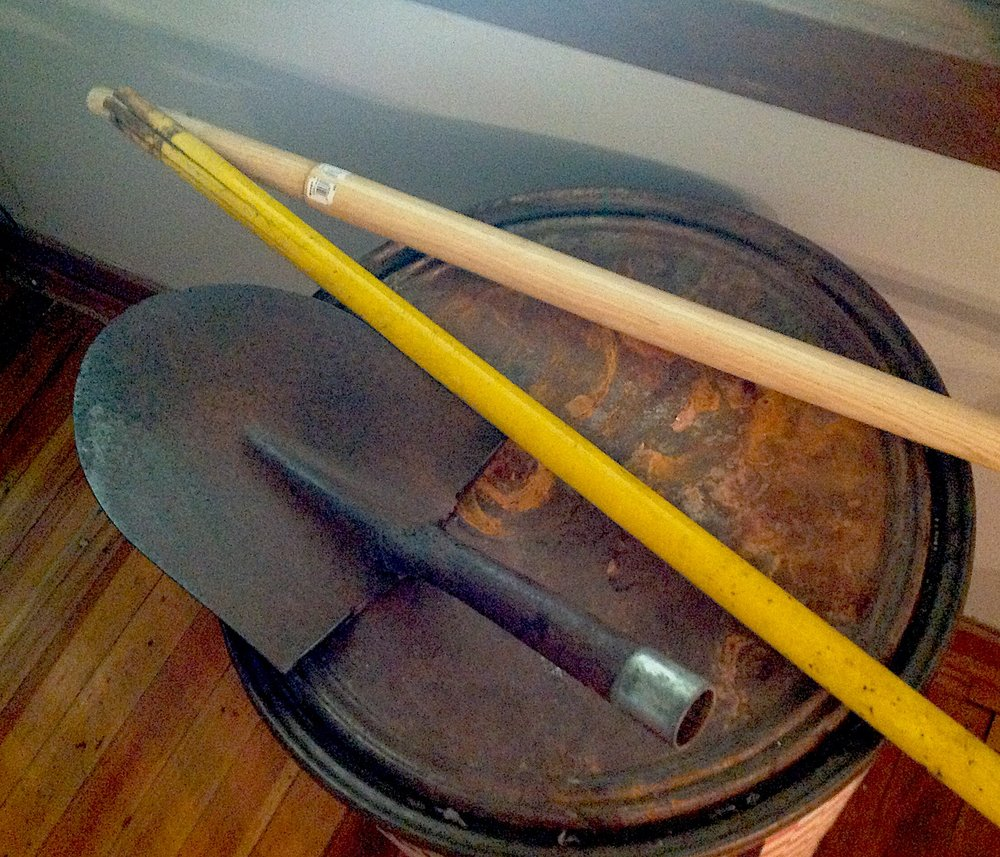 The poor old shovel . . . yellow fiber-glass handle finally gave out!