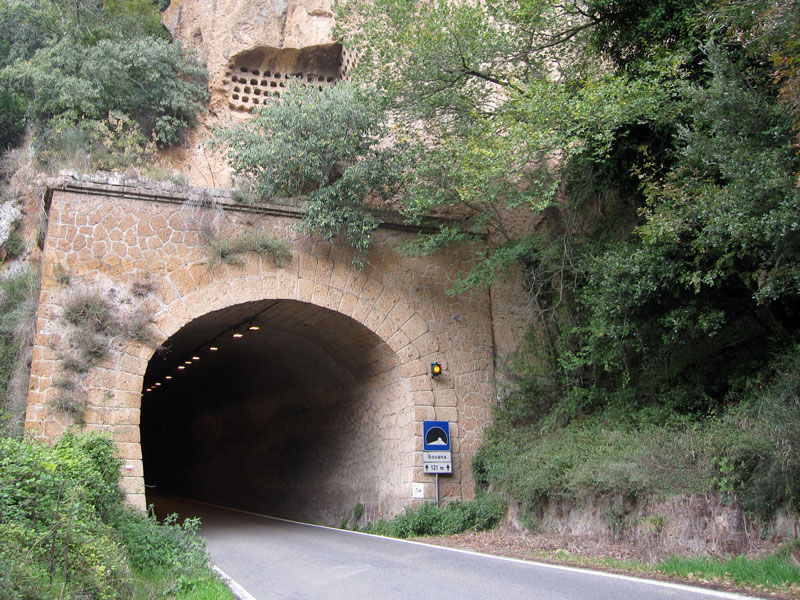 Hand-carved tunnels through the tufo stone cliffsides are remnants of the ancient Etruscans.