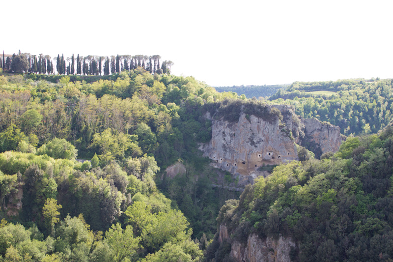 Enjoy the views from the top of Sorano and spy Etruscan tombs carved into the hillsides.
