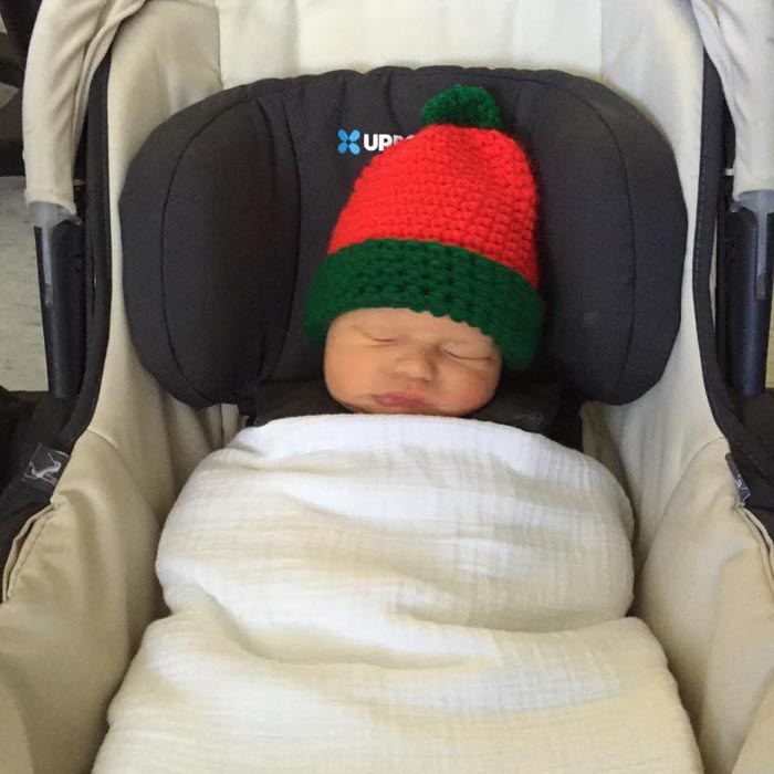 "New mom Elizabeth Van Slyke's son was the recipient of a handmade Christmas hat. ""These are so beautiful and such a sweet surprise for new moms and babies. Thank you,"" she wrote after heading home with the newborn."