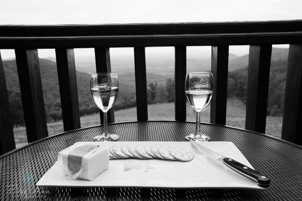 Wine, cheese and crackers on the patio at Stone Mountain Vineyards.