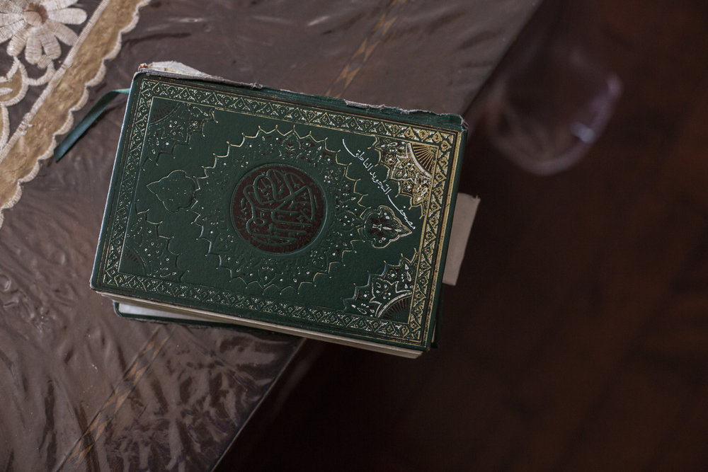 A koran sitting on the coffee table at Huda's childhood home in Greenpoint, Brooklyn.