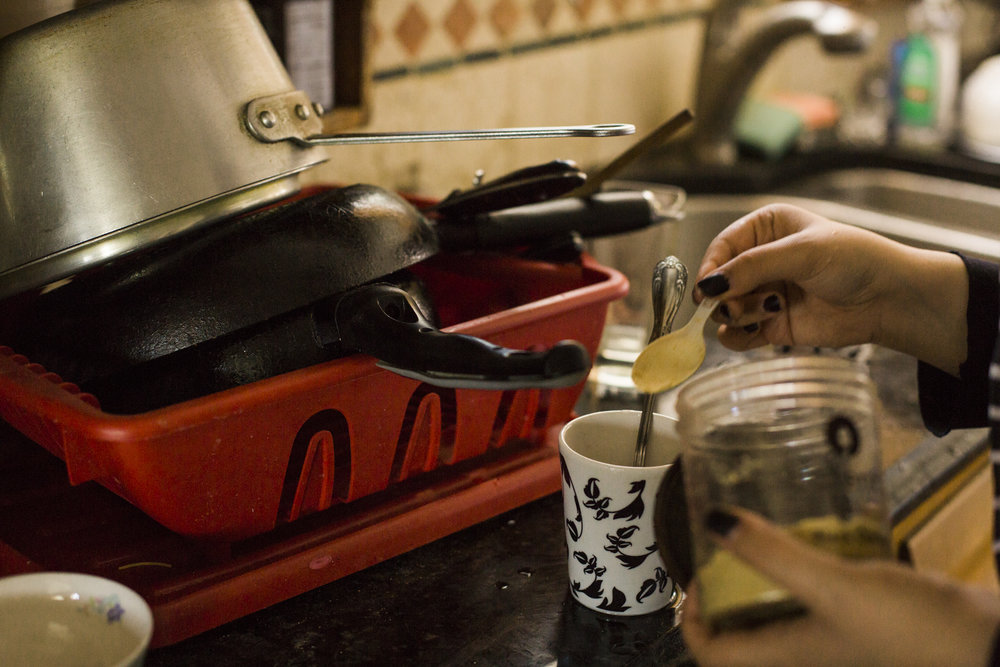 Orubba preparing Yemeni coffee for herself at her home in Canarsie, Brooklyn, New York.