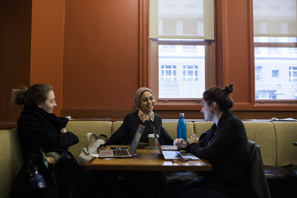 Sarah Alsaidi with members of her cohort catching up before a tutoring session in statistics at Teacher's College in Harlem, Manhattan, New York.