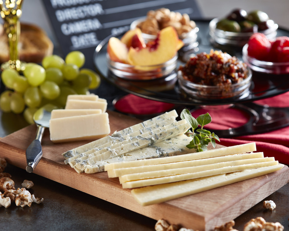 Use a film reel to hold cheeseboard accompaniments.