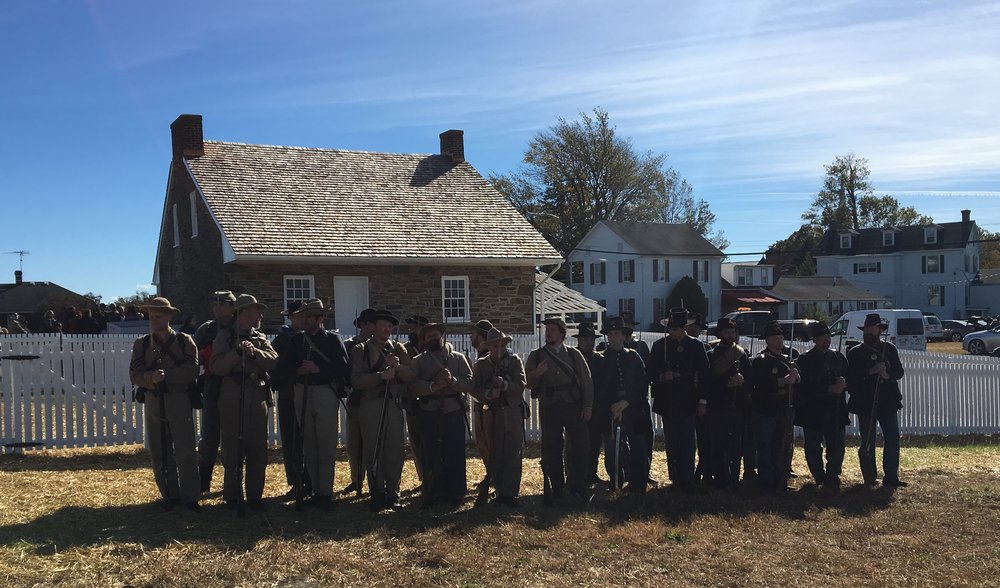 Civil War reenactors in formation during the Civil War Trust's Ribbon Cutting ceremony for General Lee's Headquarters
