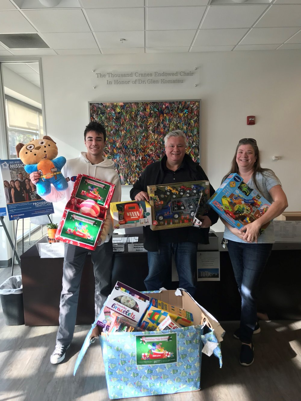 NAI Capital professionals dropping off toy donations.
