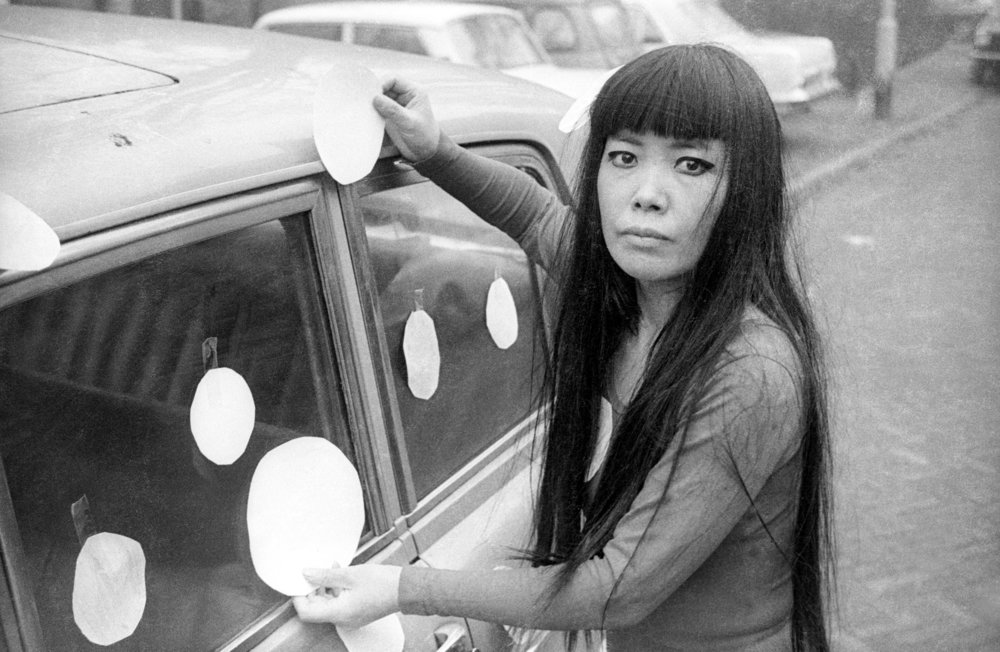 "Artist Yayoi Kusamanext to her ""Dot Car"" (1965) inKusama-Infinity, directed by Heather Lenz. Photo credit: Harrie Verstappen.Courtesy of Magnolia Pictures."