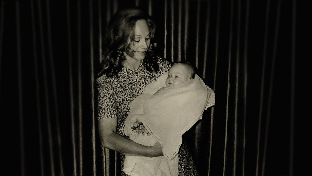 1.1 COTF - Anne Hamilton-Byrne with the first adopted child.jpg