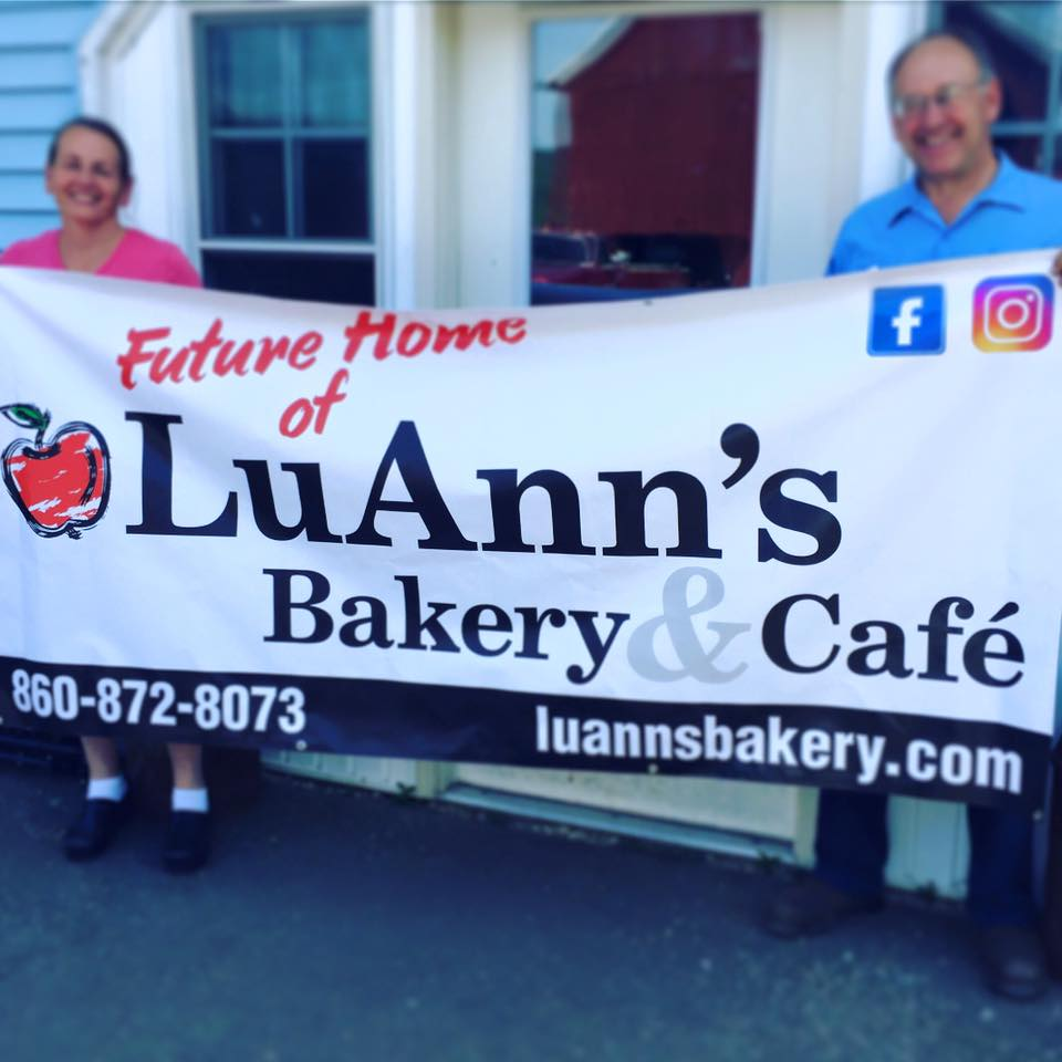 Mike & LuAnn with the sign for the new bakery building!