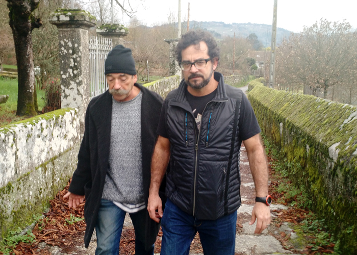 Ribeiro winemaker Emilio Rojo and importer André Tamers walk near Emilio's vineyards in northwest Spain.