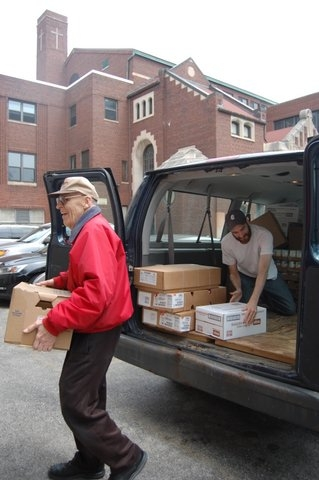 Volunteers unload food at St. Ignatius Church.