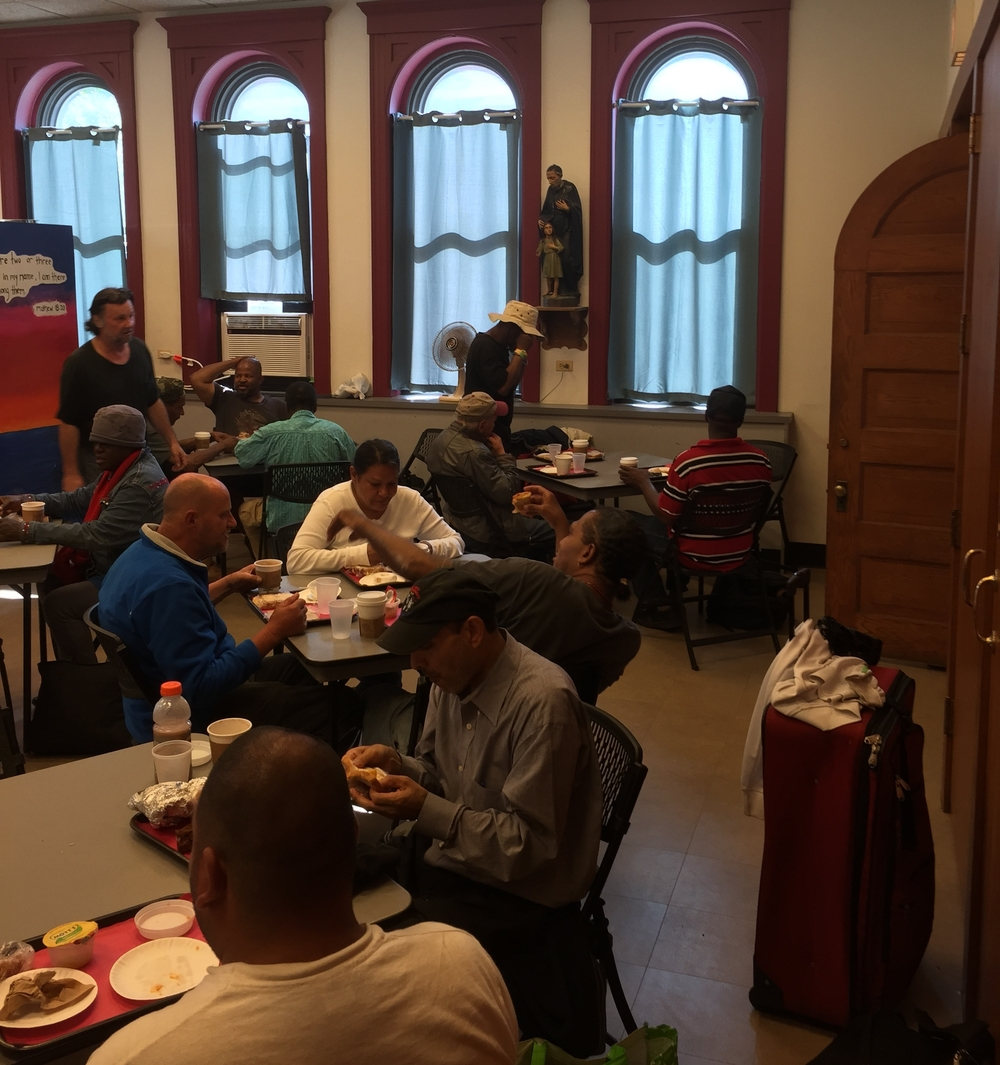 Guests Share A Meal At St. Vincent De Paul Soup Kitchen