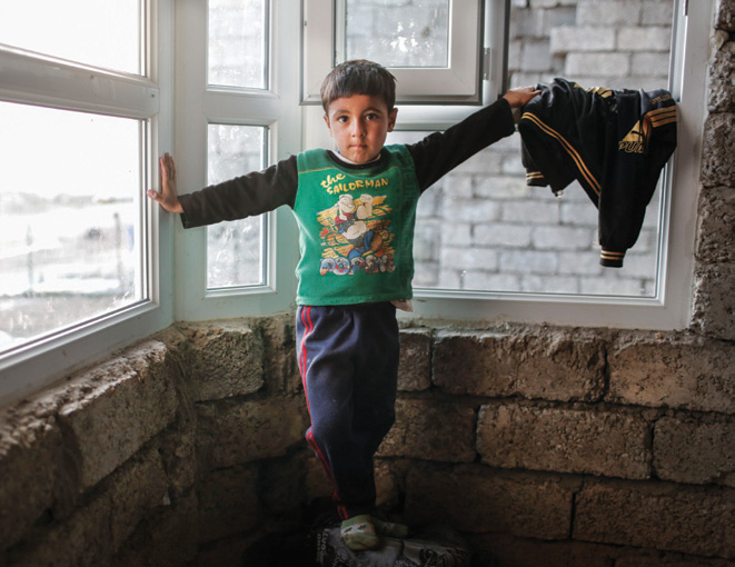 Four-year-old Raybas Dorbo was displaced when his family fled violence of IS. Photo: Sam Tarling/CRS