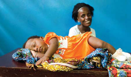 A patient and her daughter receiving postnatal care at Star of the Sea health clinic in Monrovia, Liberia. Michael Stulman/CRS