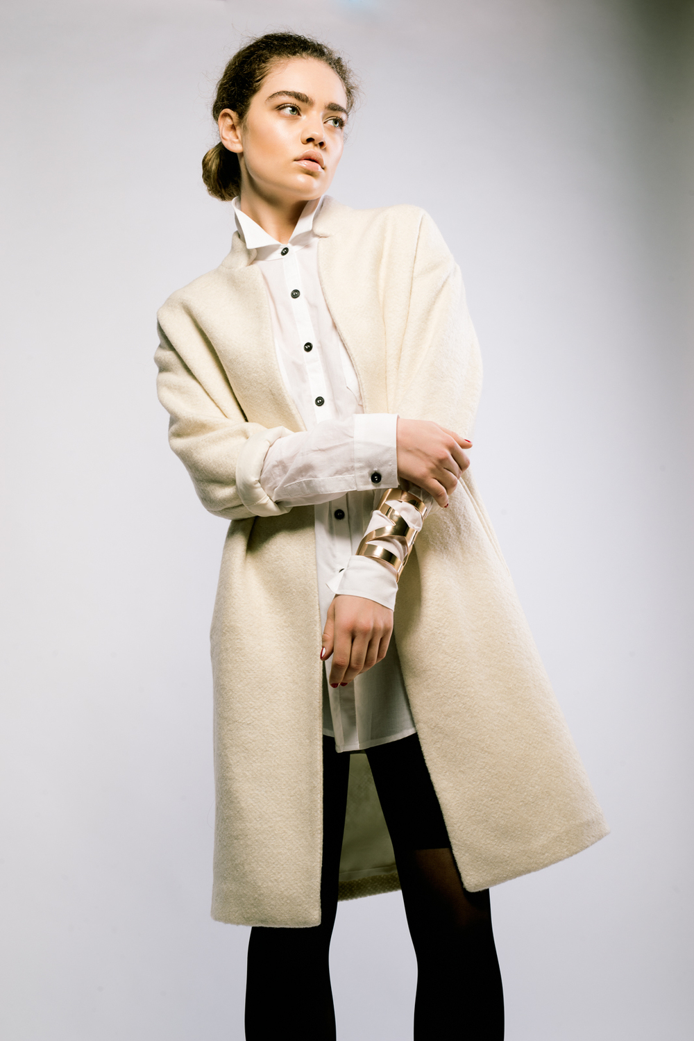 On model:  Sir & Madame Woven Shirt in white , vintage coat and bracelet.
