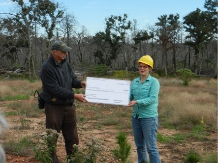 Big check to Tree Folks for forest restoration