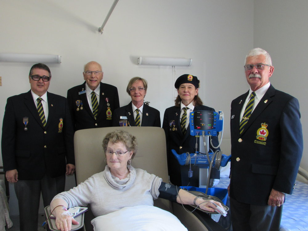 Richards Landing Branch #374 members and patient with Blood Pressure Monitor purchased with grant provided from The Royal Canadian Legion Ontario Command Branches and Ladies' Auxiliaries Charitable Foundation   (Left to right) John Shannon – Secretary, Hugh Hamilton – Charitable Foundation Chairperson, Gonny Frech - Treasurer, Anne Allaire – Branch President, Steve Frech – District H Commander, Barbara Gajda – Patient