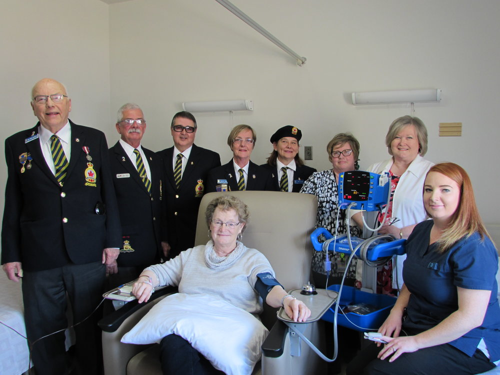 Richards Landing Branch #374 members, NSHN Richard Landing – Matthews site and patient with Blood Pressure Monitor purchased with grant provided from The Royal Canadian Legion Ontario Command Branches and Ladies' Auxiliaries Charitable Foundation.   (Left to right) Hugh Hamilton – Charitable Foundation Chairperson, Steve Frech – District H Commander, John Shannon – Secretary, Gonny Frech – Treasurer, Anne Allaire – Branch President, Bonnie Campbell – RN, Lynn Jobst RN – Richards Landing – Matthews / Thessalon Site Manager, Amanda Haner – PSW