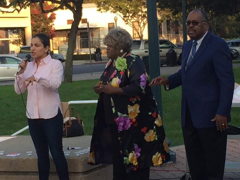Bishop Macklin, NAACP President Freddye Davis and Aisha