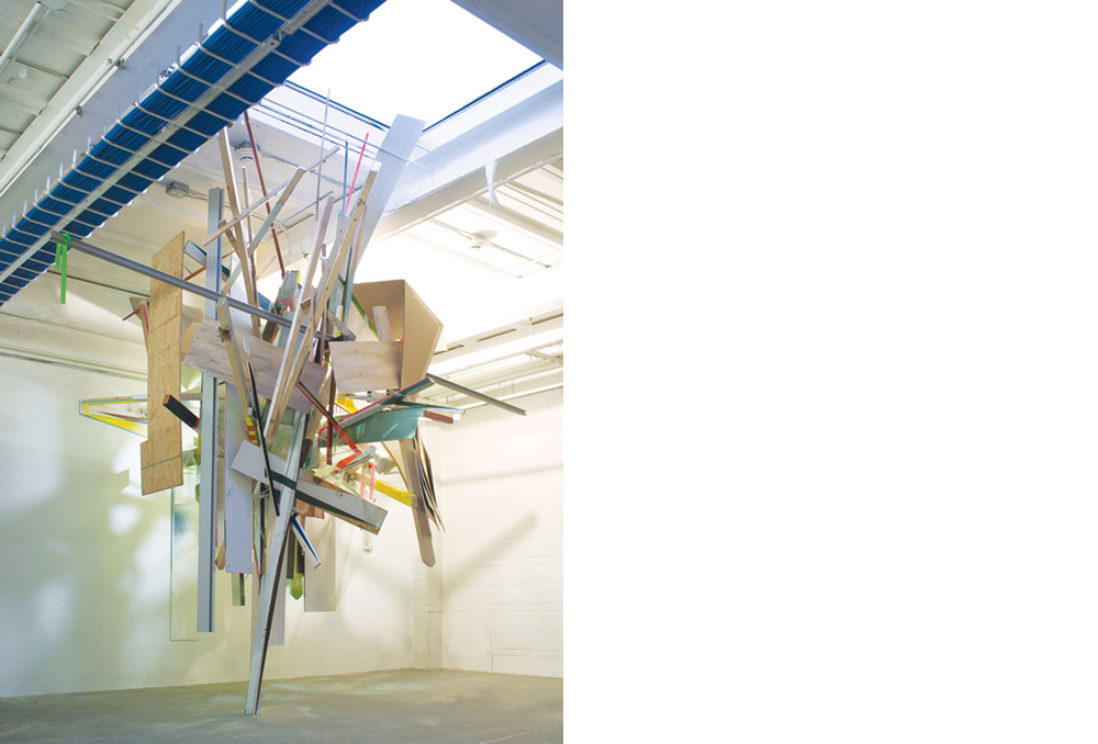 HANGAR    Site specific installation with wood, cellophane, aluminum, acrylic paint, spray enamel, cardboard, compact fluorescent light bulbs, extension cords, clear polyethylene sheeting, vinyl siding, flagging tape and salvaged building materials, 144 x 168 x 168 inches, 2012
