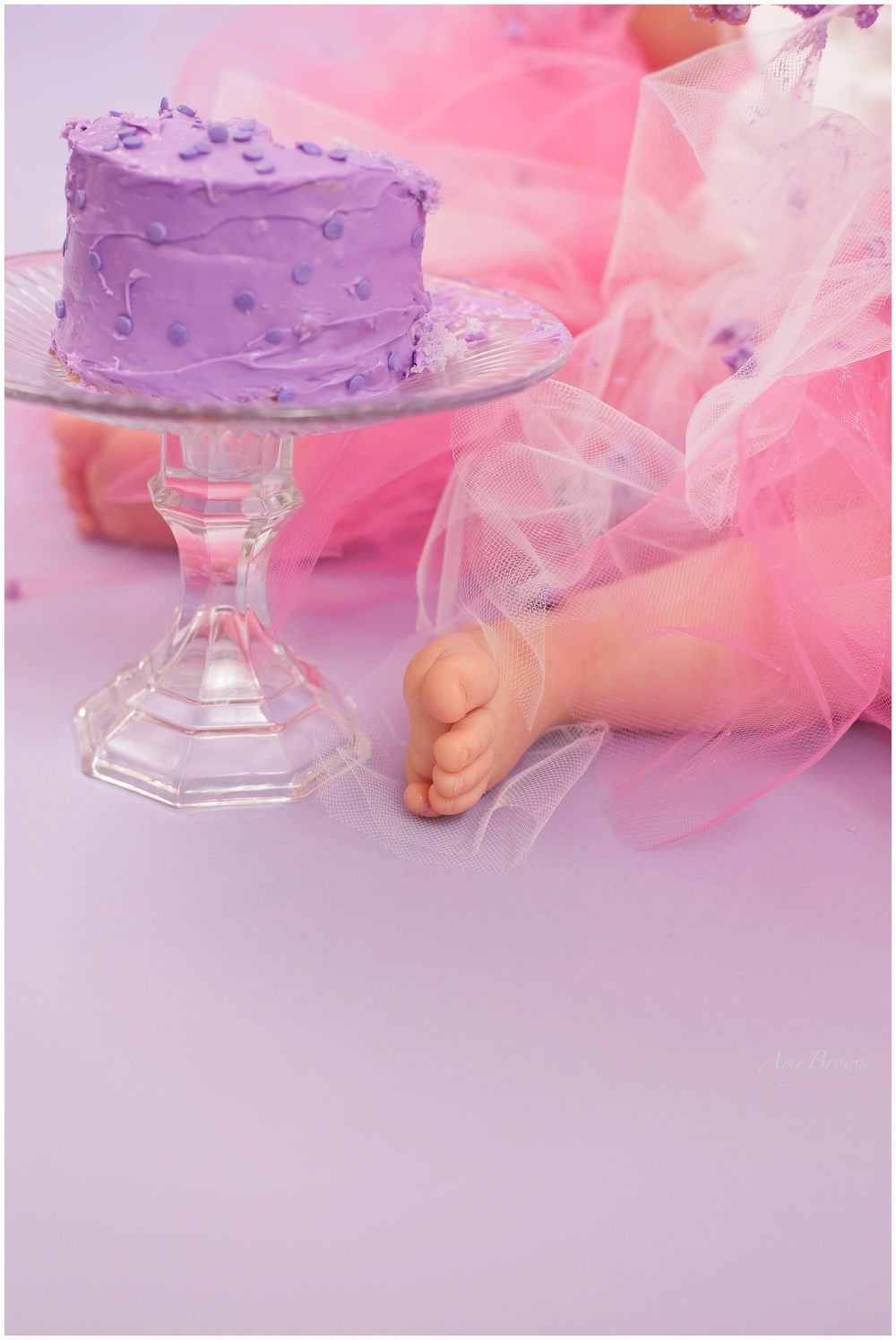 Seacoast NH Family Photographer | Cake Smash Session Set Up | Purple and Pink birtday cake | NH family photographer | Amy Brown Photography