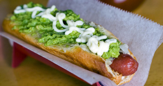 Completo  - Chile's take on the hot dog. Completos are surprisingly one of the most beloved Chilean foods, sold in sandwich shops and stands throughout the country. A typical completo is served with sausage, chopped tomato, a ton mayonnaise, cheese and sauerkraut.