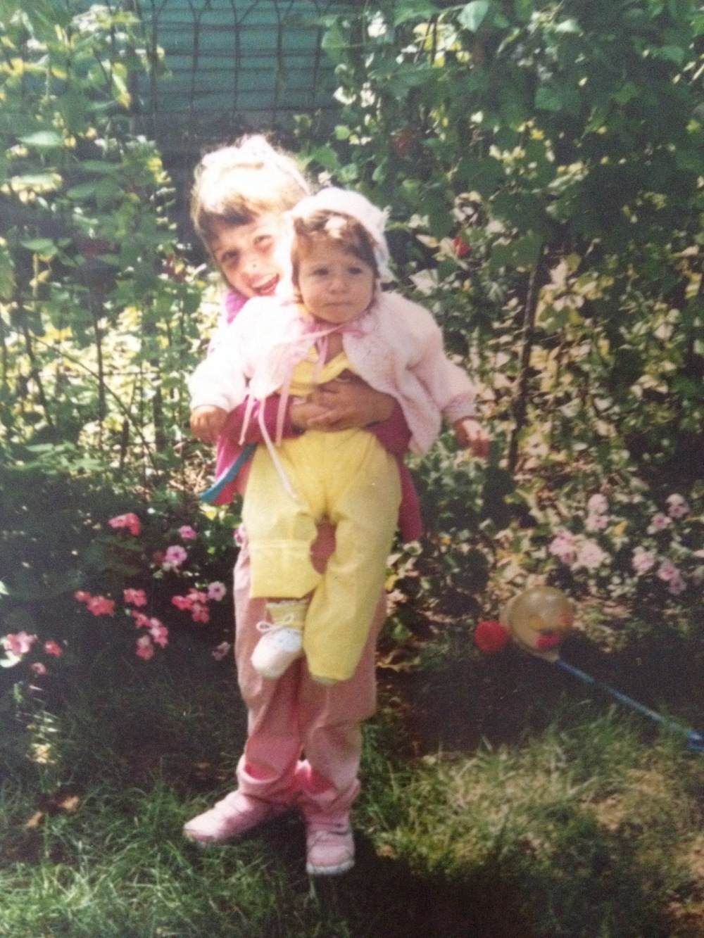 Is this the proper way to hold a baby? Also, I don't know why this photo is squished. Internet, please help! One more also -- this is me and my sister.