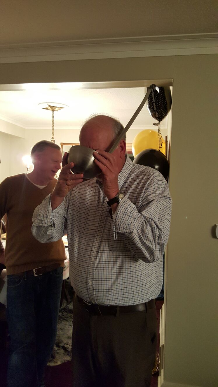 Uncle Jim appreciates a good drink in a stainless steel ladle.