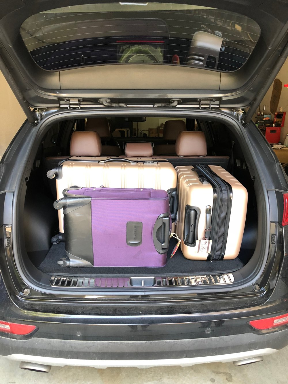 Hitting the road with a car full of suitcases.