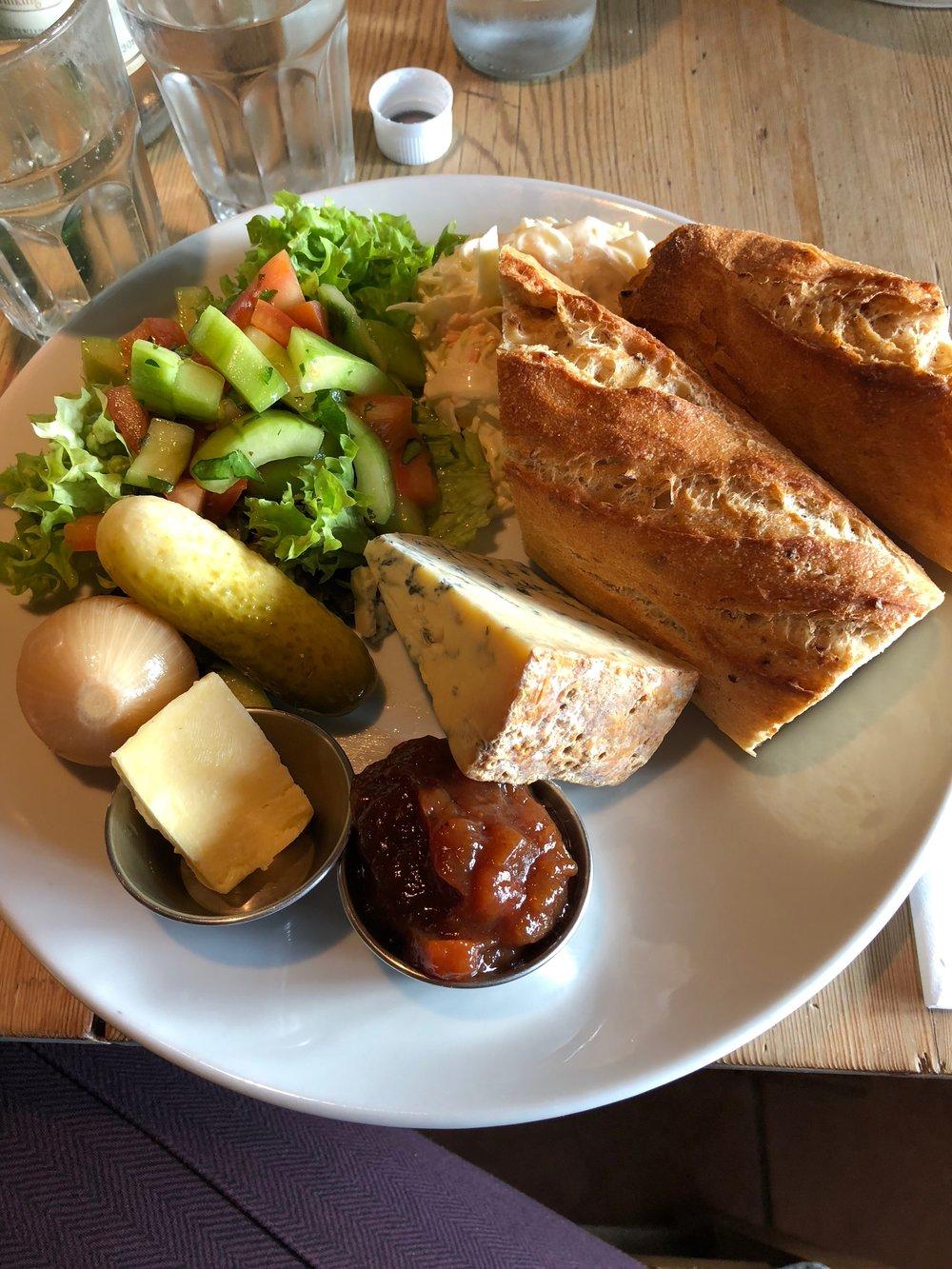 Ploughman's: bread, chutney, butter, stilton, pickled onion, pickled pickle, salad, coleslaw